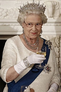 Queen Elizabeth II sips on a glass of wine.