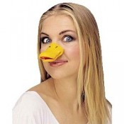 A pretty girl is wearing a duck's beak, making her ugly.