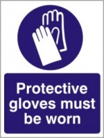 A sign warns gifted adults to wear gloves when dealing with their own trash